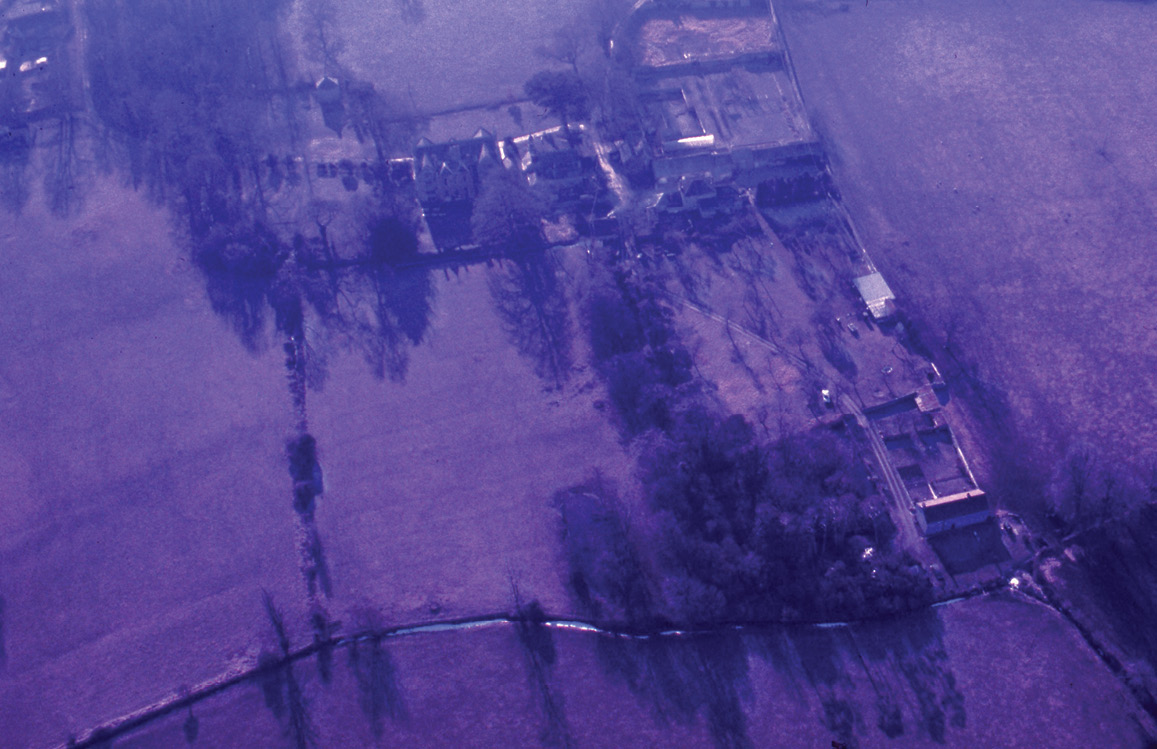 below Aerial photograph of Shapwick, Somerset, taken 30 January 1987. The two images show dye-colour degradation (HEIR ID 64884) and the same photograph with digital colour-correction.