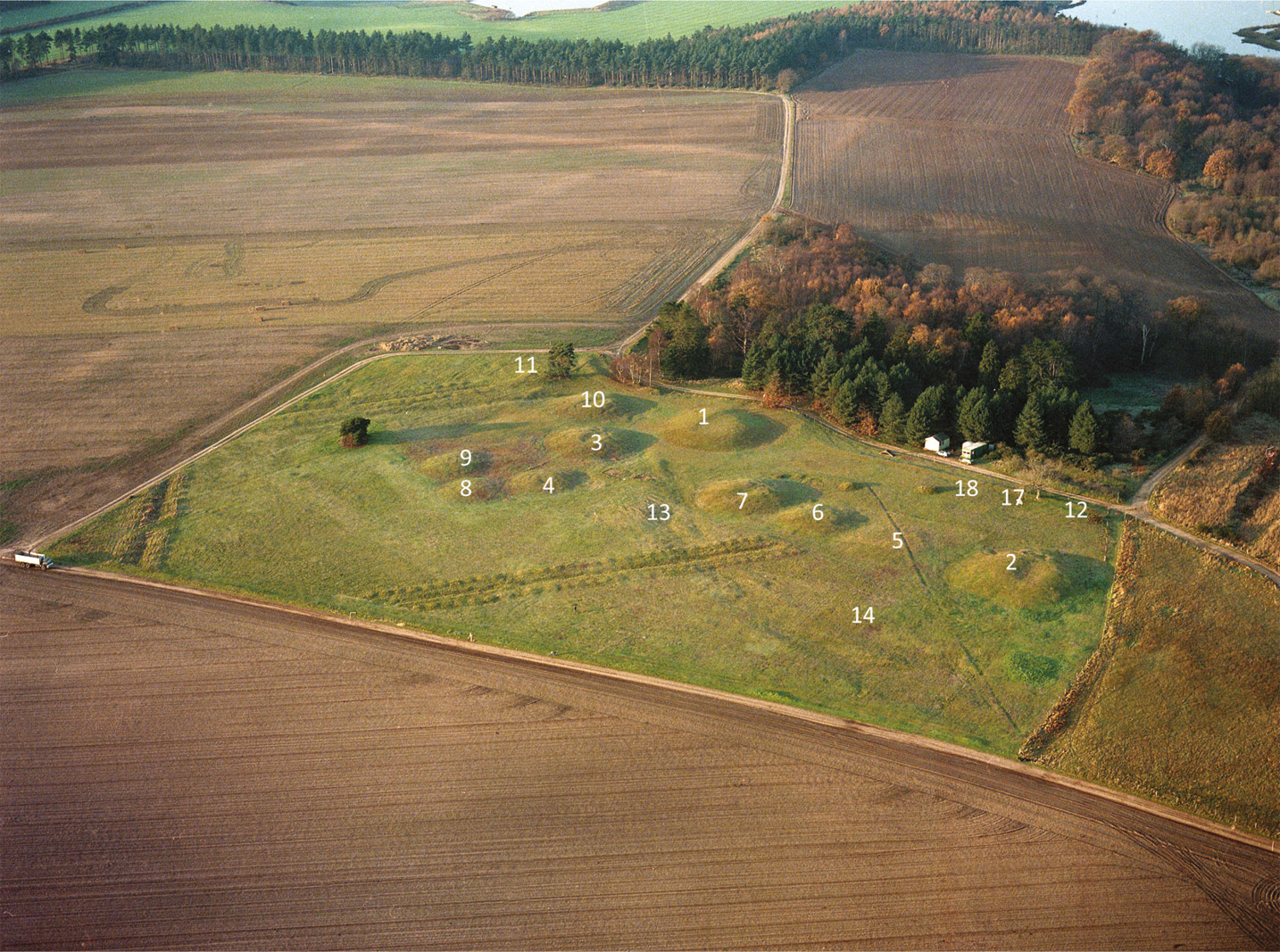 left Overlooking the Sutton Hoo barrow cemetery: Mound 1 is the ship burial excavated in 1939; Mound 14, which was the burial of an elite woman, lies in the bottom right corner of the site.