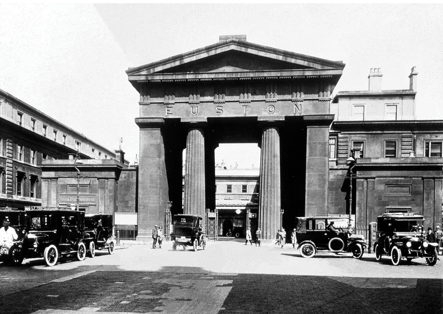 left Two 'lost vistas' in London: Euston Arch, Euston station, London, c.1925 (HEIR ID 44180; photographer unknown), which was built in 1837 and demolished in 1962; and the original Charing Cross station hotel, c.1893 (HEIR ID 36933; photograph sold by Wrench & Son from 1893). Its upper floors were destroyed in the Second World War, and the replacement levels do not follow the original design. The crack seen upper left is present in the original lantern slide.