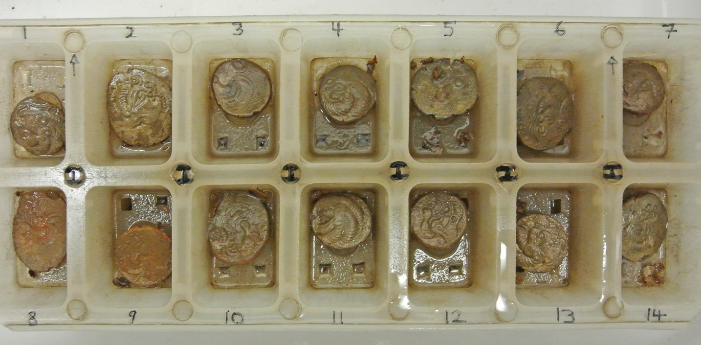 ABOVE Converted ice-cube trays were used to help keep track of coins while they underwent treatment. These staters are individually recorded as I,1-14.