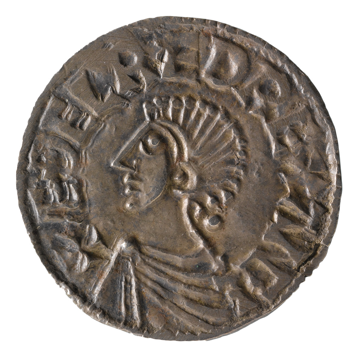 BELOW A high point in Exeter's story came in the late Saxon period, when it was fortified as a burh and became an important mint. This is a Long Cross coin of Æthelred II (r. 978-1013 and 1014-1016), minted in the town by the moneyer Dunstan.