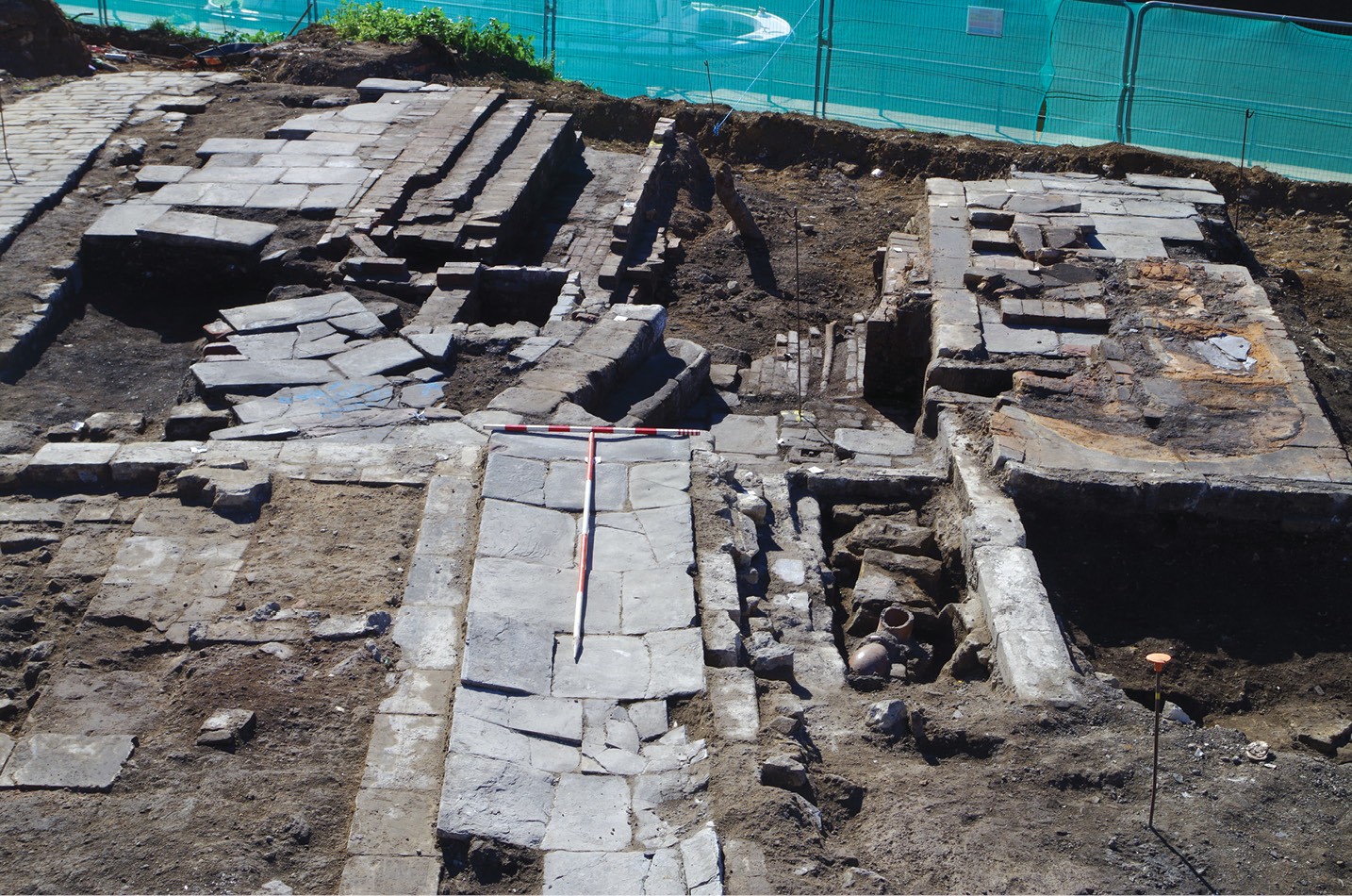 LEFT Excavating the boiler room, showing steam boiler bases dating from the wash house's expansion in 1853. The top image shows the cubicles of the site's laundry stalls.