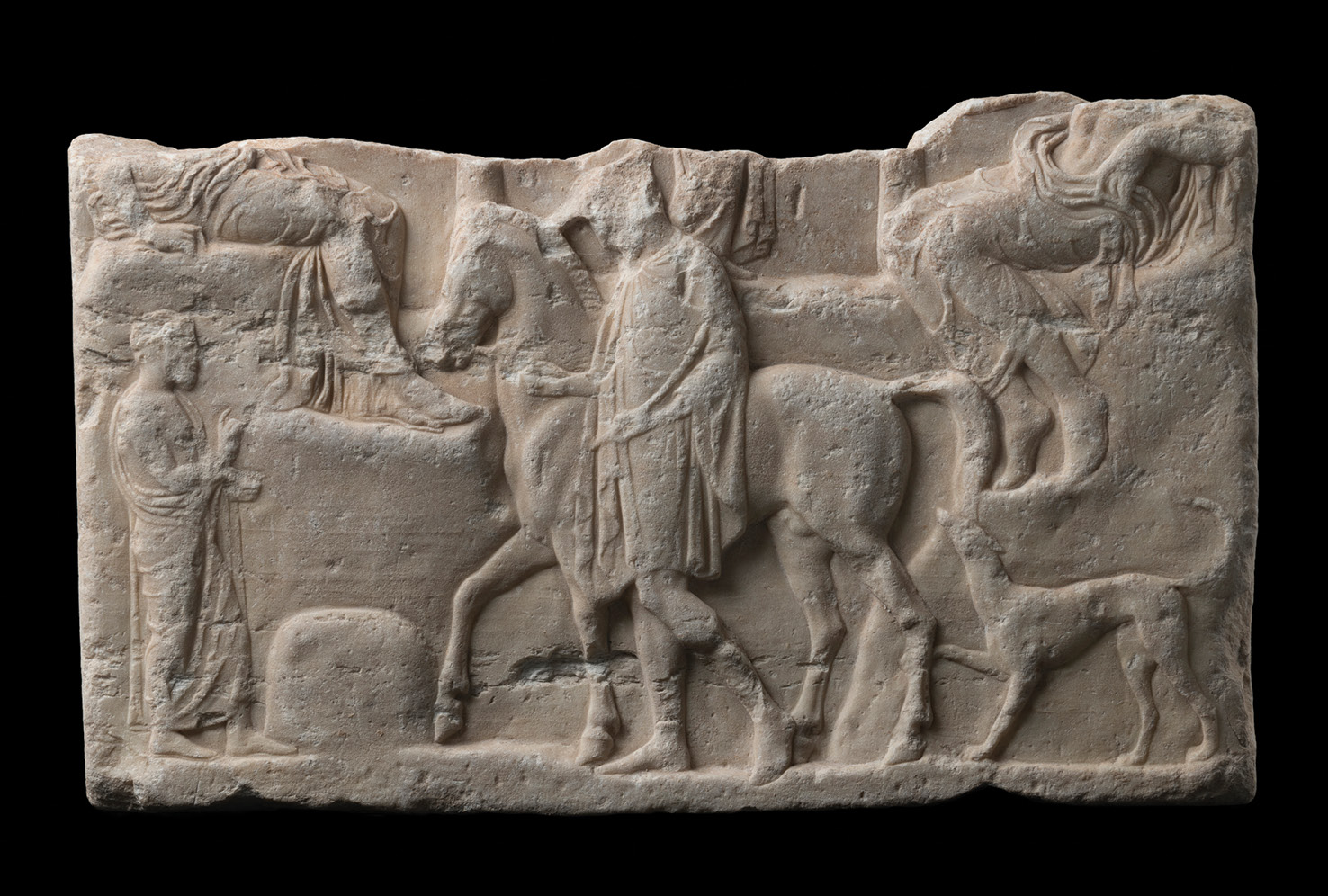 BELOW This votive relief dates to the 5th century BC and probably came from the acropolis in Athens. It shows a man holding a horse, with a dog behind, while the bottom portion of a god and goddess can be seen perched on a rocky slope. The sculpture was reportedly discovered during digging near Herodes' estate in Rome, and so it probably passed from a 2nd-century AD collection to a 19th-century one.