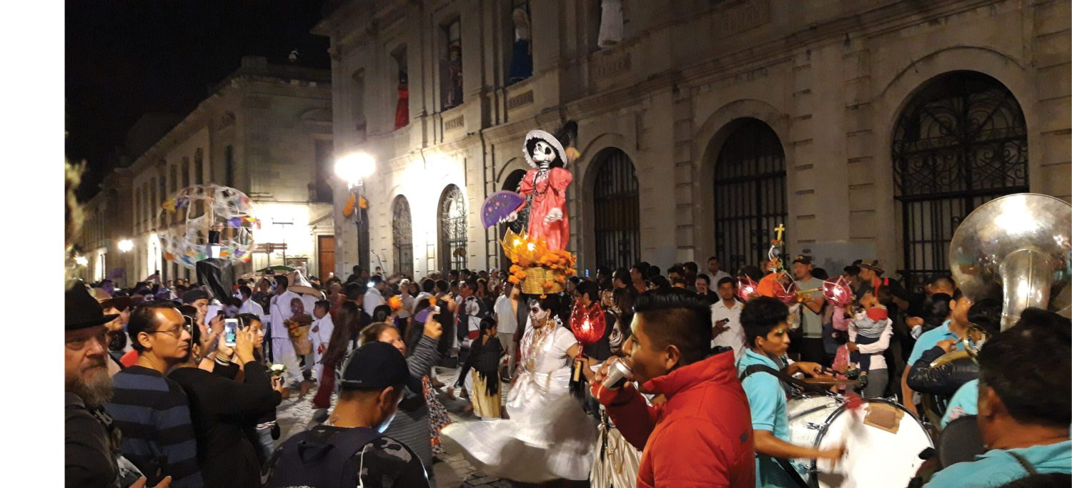above One of the comparsas informal but joyfully chaotic parades organised by different barrios or neighbourhoods that wound through Oaxaca's streets in the run-up to the Day of the Dead and during the festivities.