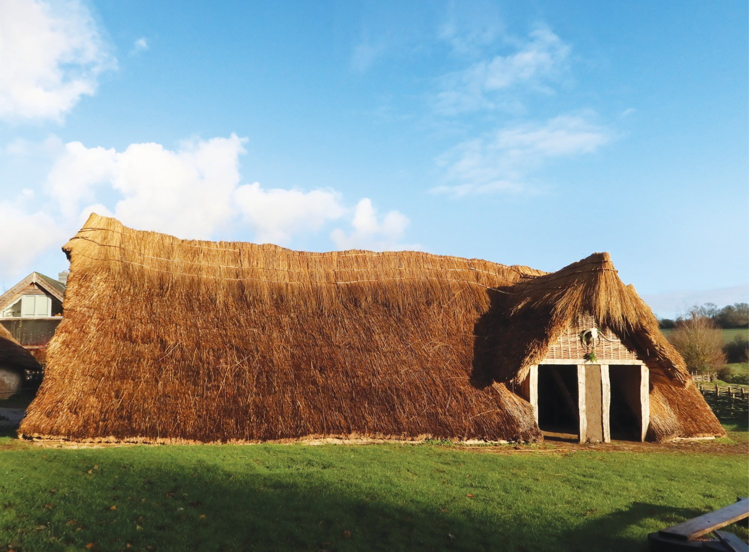 Above The new Neolithic: Butser Ancient Farm's latest reconstructed building is based on the remains of a nearly 6,000- year-old house that was excavated by Wessex Archaeology in Berkshire.