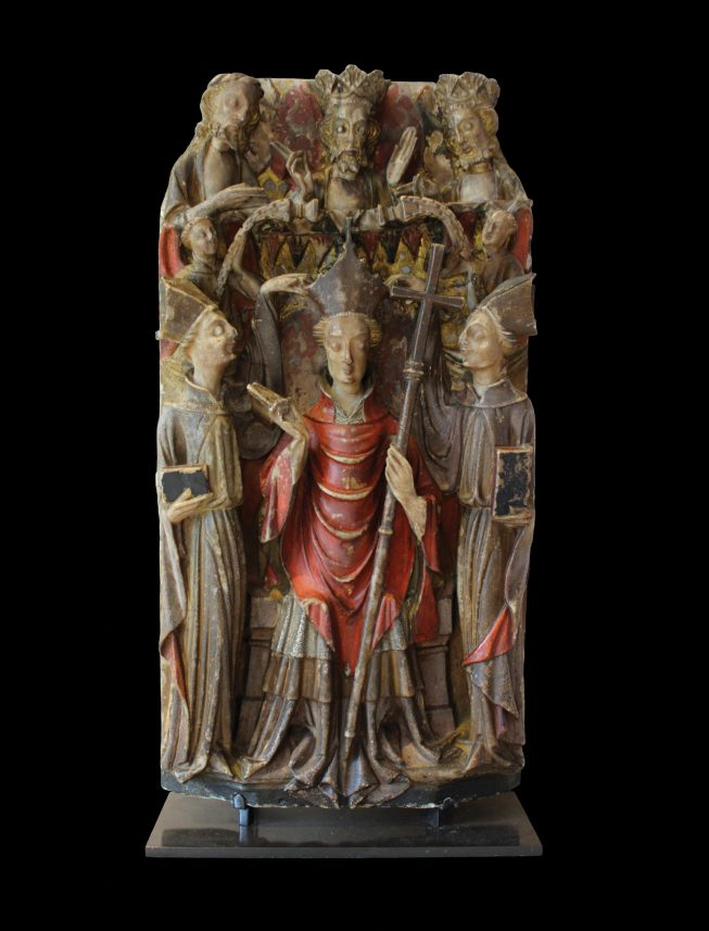 OPPOSITE Alabaster panel from an altarpiece showing Becket's consecration as archbishop, first half of the 15th century. Size: 49 x 24 x 4cm