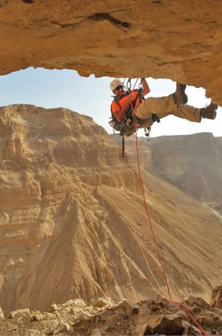 ABOVE Many of the caves surveyed were accessible only by rappelling.