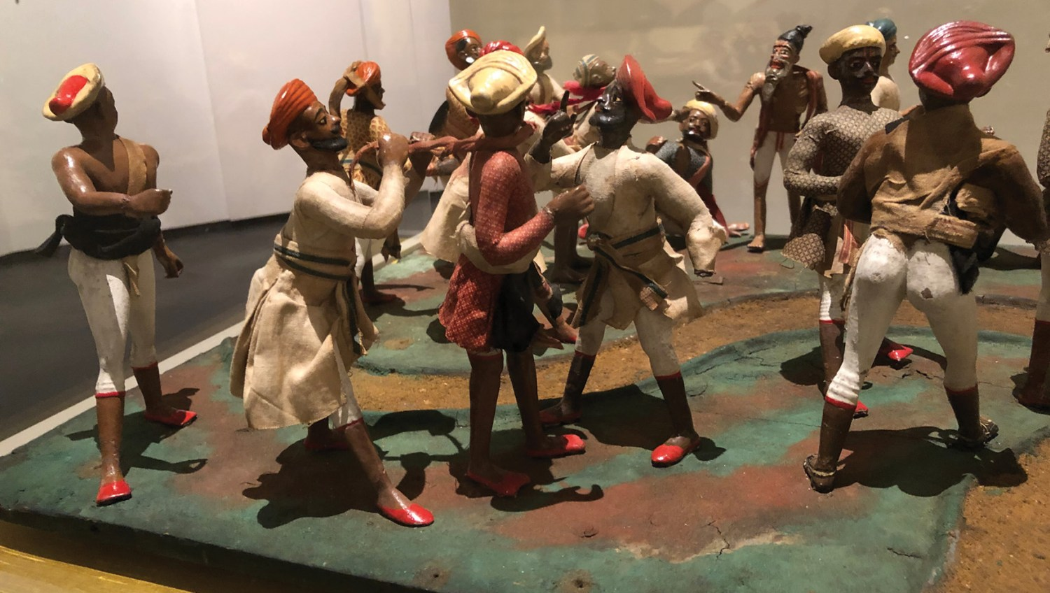 BELOW An early 19th-century model from India, showing travellers being assaulted and slain by Thugs.