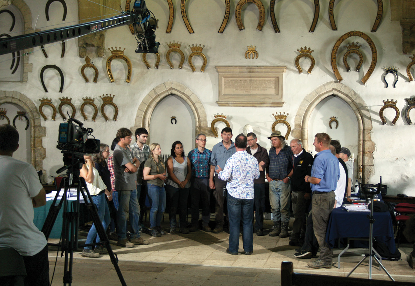 right The team being directed inside the magnificent 12th-century great hall at Oakham Castle for the final shot of an episode in the forthcoming season 20. The ornate horseshoes stem from a tradition dating back to Edward IV in 1470 that peers of the realm should donate one when they visit. A local blacksmith cast a special horseshoe in honour of Time Team's visit (inset).
