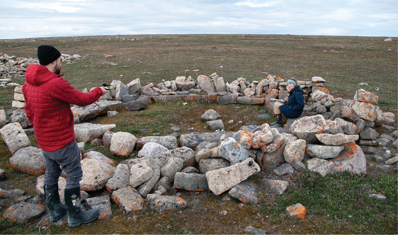 below Sitting on the well-preserved bench in a Historic Inuit meeting house on Igloolik. right Fresh pitsik (dried Arctic char) hanging out to dry.