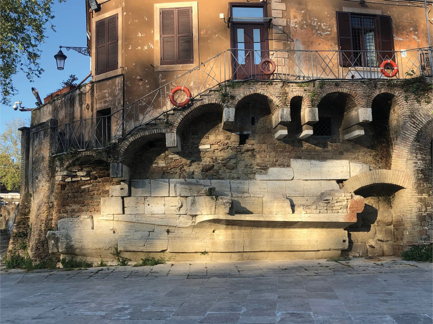 LEFT The Tiber Island's resemblance to a warship inspired the Romans to dress the downstream end in masonry sculpted into the form of a prow. This faux trireme was decorated with the head of healing god Asclepius, his snake-entwined staff plainly visible (BELOW).