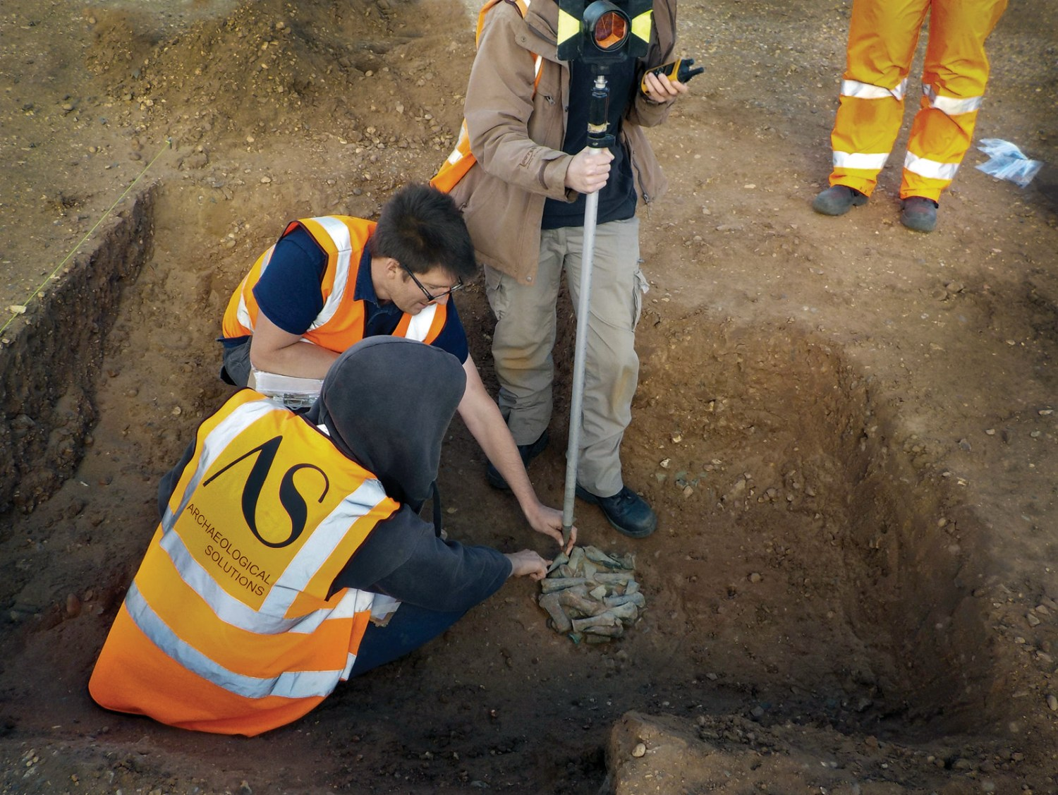 below The hoard was not a single deposit, but four 'packages' of bronze arranged around the floor of a pit. One of these is shown being recorded by Archaeological Solutions.