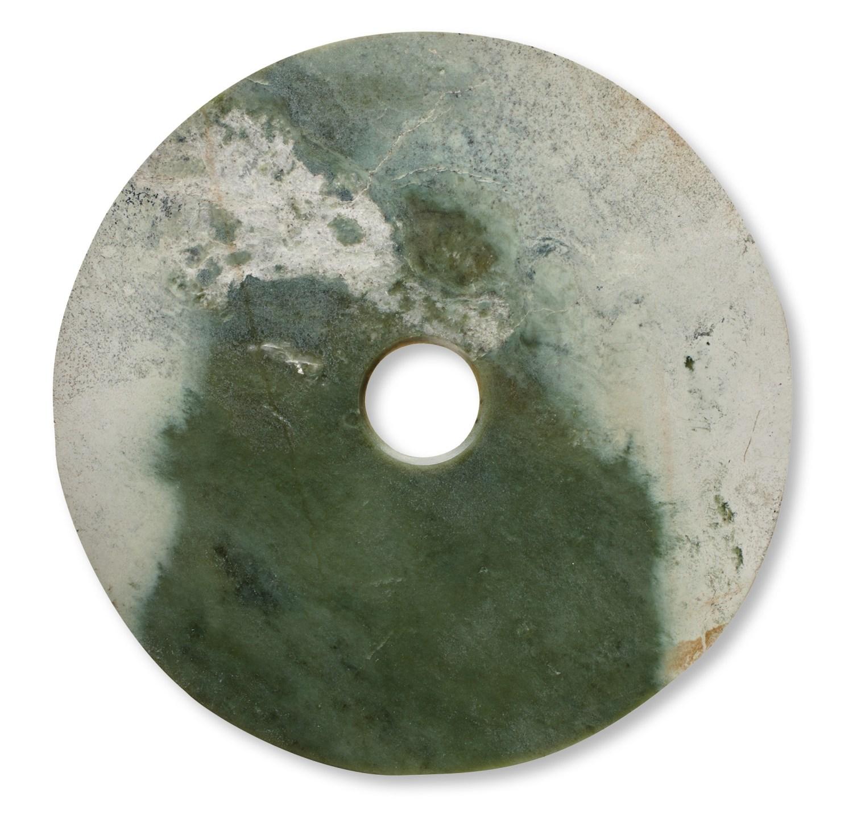 above Jade bi disc, Qijia culture, c.2300-1500 BC. Size: 37.6cm right Jade cong, Liangzhu culture, c.3300-2200 BC. Size: 50.4 x 7.2cm