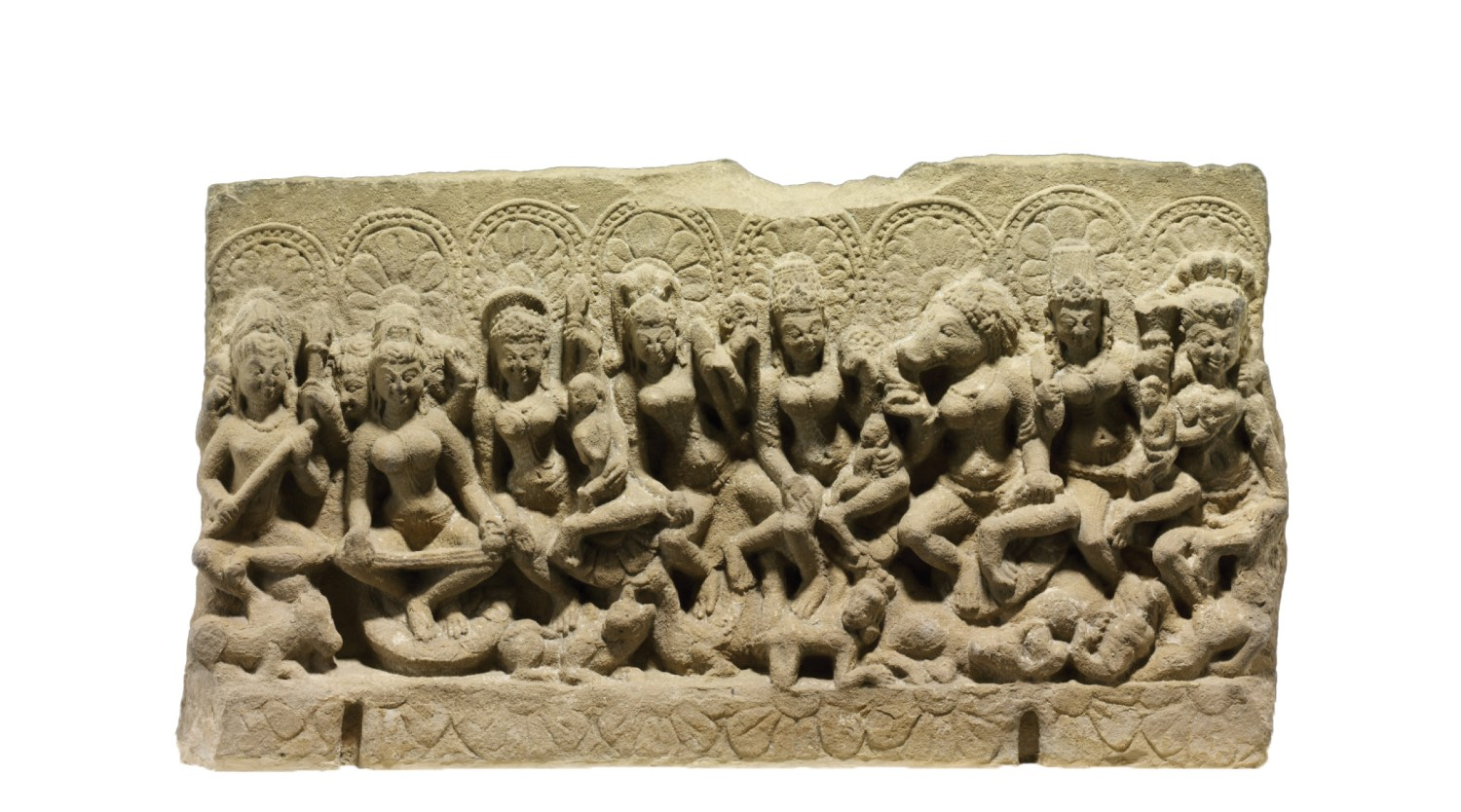 ABOVE Sculpted panel, possibly from a lintel above a temple door, showing the Sapta-Matrikas (Seven Mothers) accompanied by Shiva, from Madya Pradesh, Gurjara-Pratihara dynasty, 10th century. Sandstone. Size: 39.4 x 72