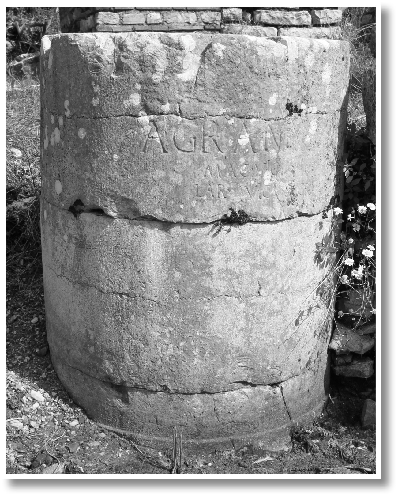LEFT On the western side of the compitum is a marble altar dedicated by Aulus Granius to the Lares Compitales. Granius' name appears again on a rectangular marble pedestal dedicated to Stata Mater, seen here in a 1964 excavation photograph (inset).
