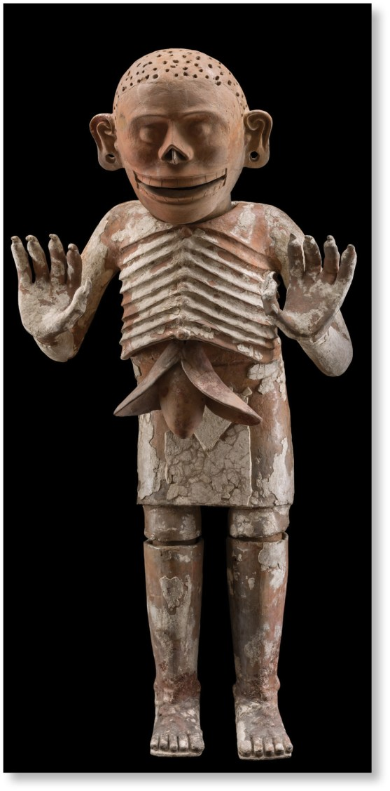 left A serpentine figure from Teotihuacan (AD 250-750), engraved with calendar signs by Aztec artists. Size: 34 x 17.5 x 7cm right One of a pair of almost identical painted ceramic sculptures of Mictlantecuhtli, Lord of the Underworld (1430-1502), found in fragments in the House of the Eagles. Size: 176 x 80 x 50cm below Jewel in the shape of a heart, discovered in an ofrenda at the Templo Mayor, early 16th century. Size: 4.1 x 2.6cm
