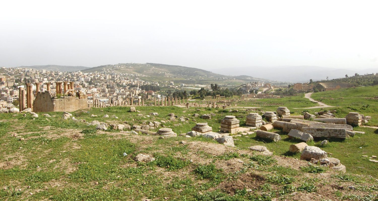 BELOW The ruins of Jerash seen from the north-western part of the city, where a Danish-German team have shed new light on activity in this so-called 'peripheral' area. In the foreground are the remains of the Synagogue Church, and to the left is the large Artemis Temple. To the right is the South Theatre and the Oval Piazza, and in-between is the Temple of Zeus.