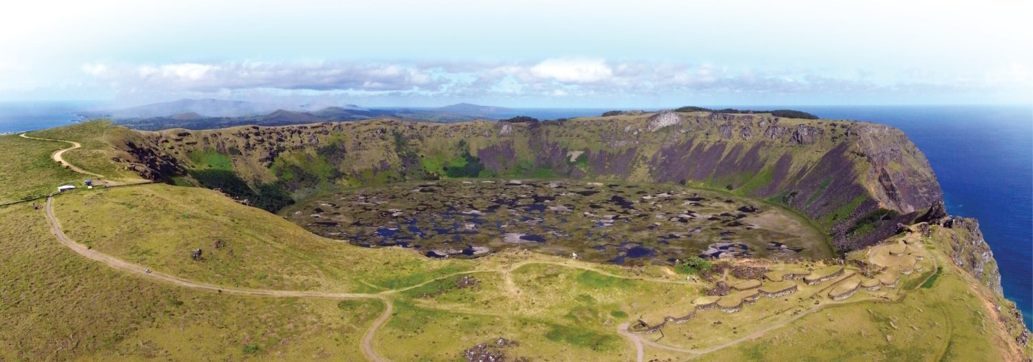 left Panoramic view of the crater Rano Kau with Orongo village, centre of the birdman cult on Easter Island. inset Painted slab with facing birdmen belonging to the collections of the Museo Antropológico Padre Sebastián Englert (MAPSE) Easter Island.