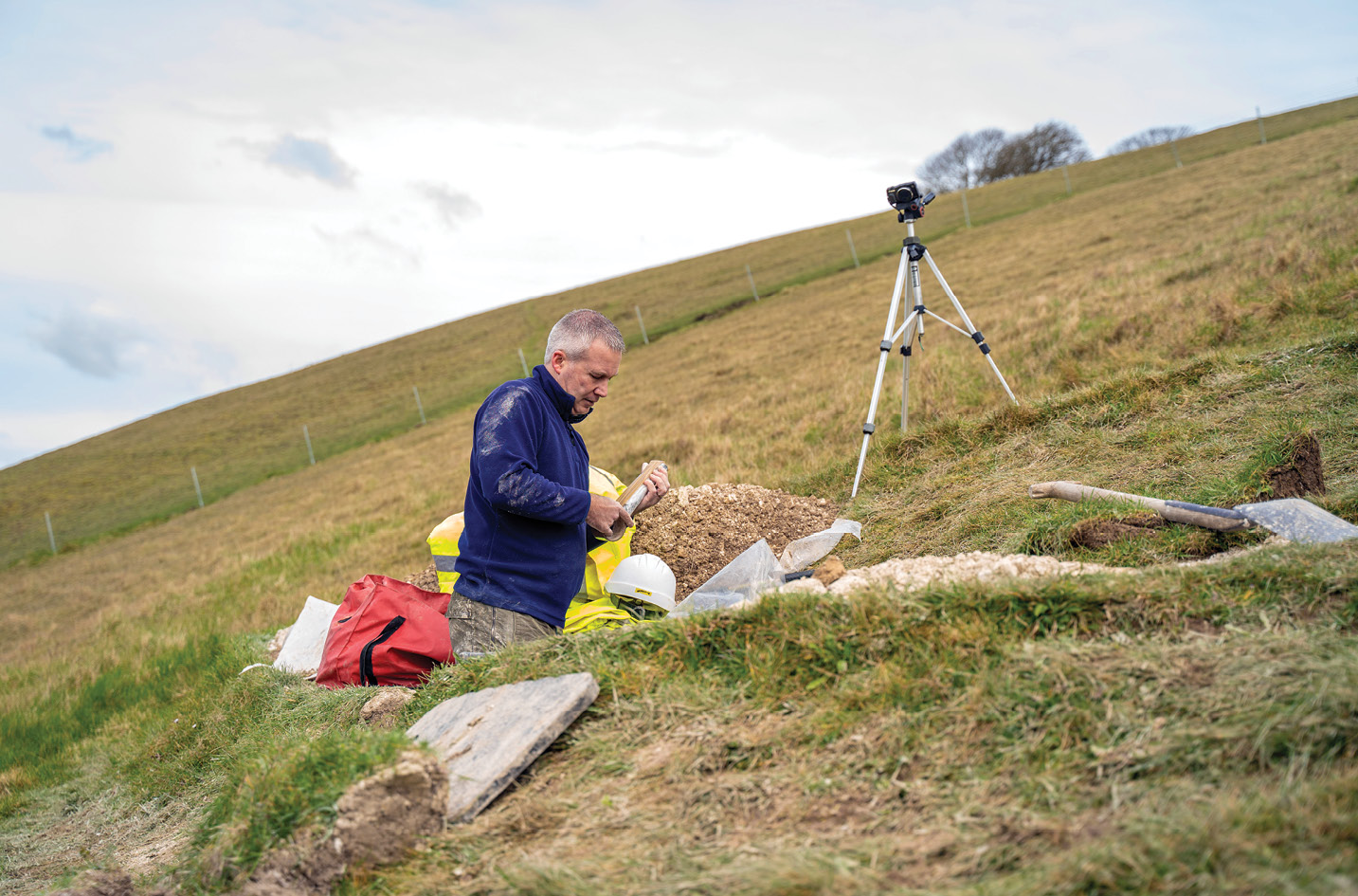 below Professor Phillip Toms of the University of Gloucestershire, shown here labelling samples from the Giant, carried out the OSL analysis that established new dating evidence for the hill figure.