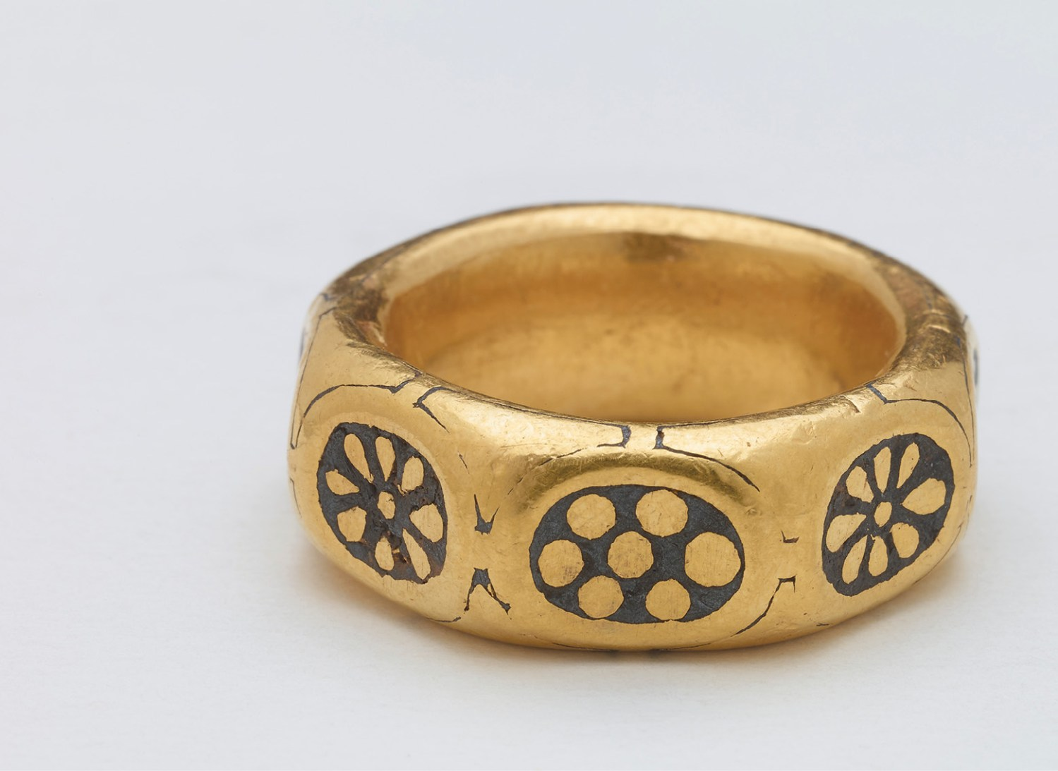 BELOW A chunky octagonal gold finger ring (external diameter: 29.4-30.3mm) was also among the recovered artefacts; its decorations place it in the 9th century. RIGHT This arm-ring or bracelet is closed by a stylised animal head apparently biting its own tail; it is probably of 9th-century Anglo-Saxon manufacture. Its external diameter is 86.4mm by 74.9mm.