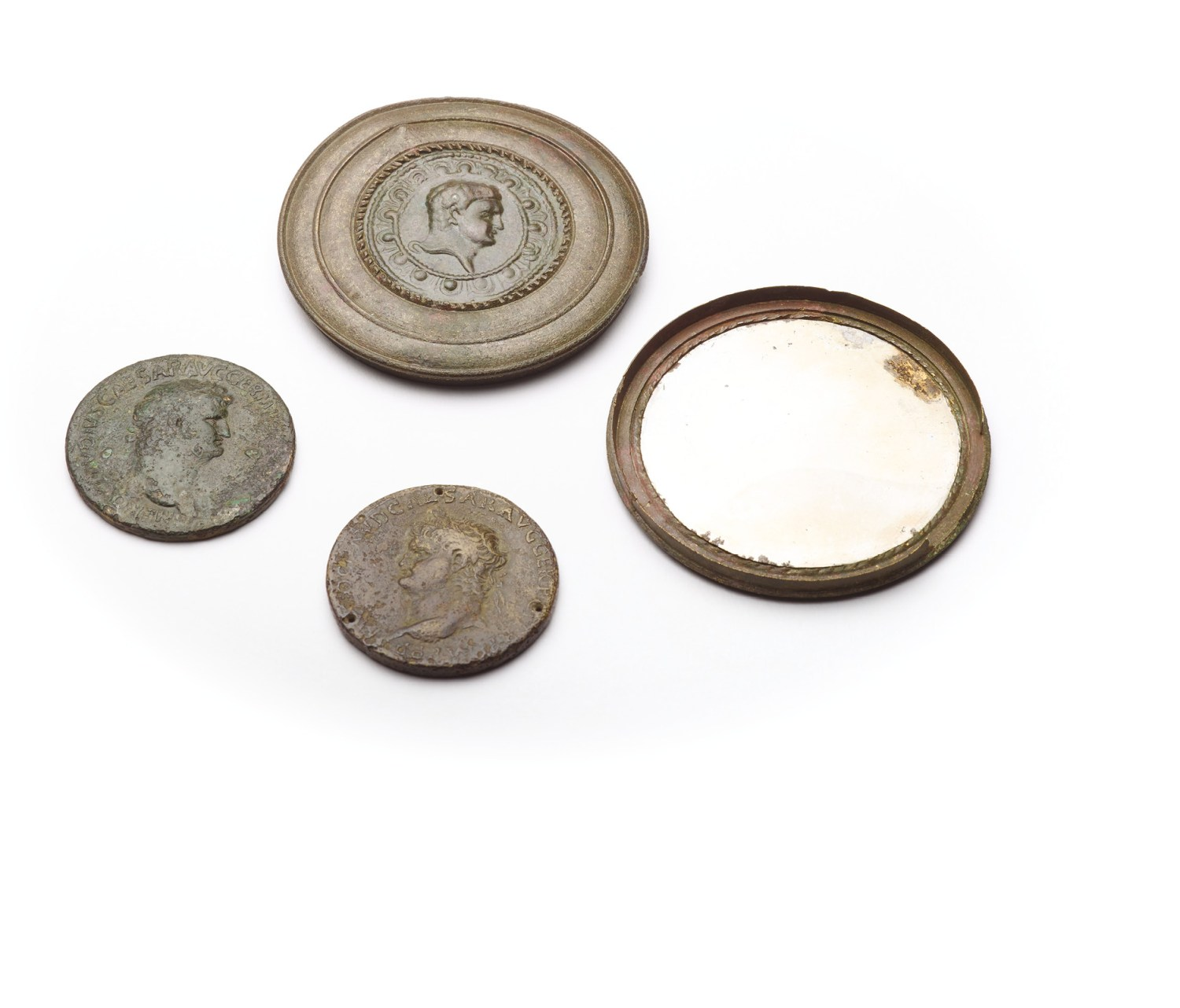 left These are mirror cases decorated with coins bearing Nero's portrait. Found near Paris in France and Coddenham in Suffolk, they are thought to represent supporters of the emperor unlike public displays of loyalty, which may have been driven by political expediency or self-interest, the incorporation of Nero's image into a personal object like this might hint at more genuine admiration.