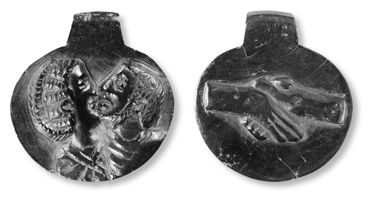 below Carved on both sides, this jet pendant from Vindolanda would have been given as a betrothal gift. It shows an undeniably affectionate, but anonymous, couple, and a pair of clasped hands.