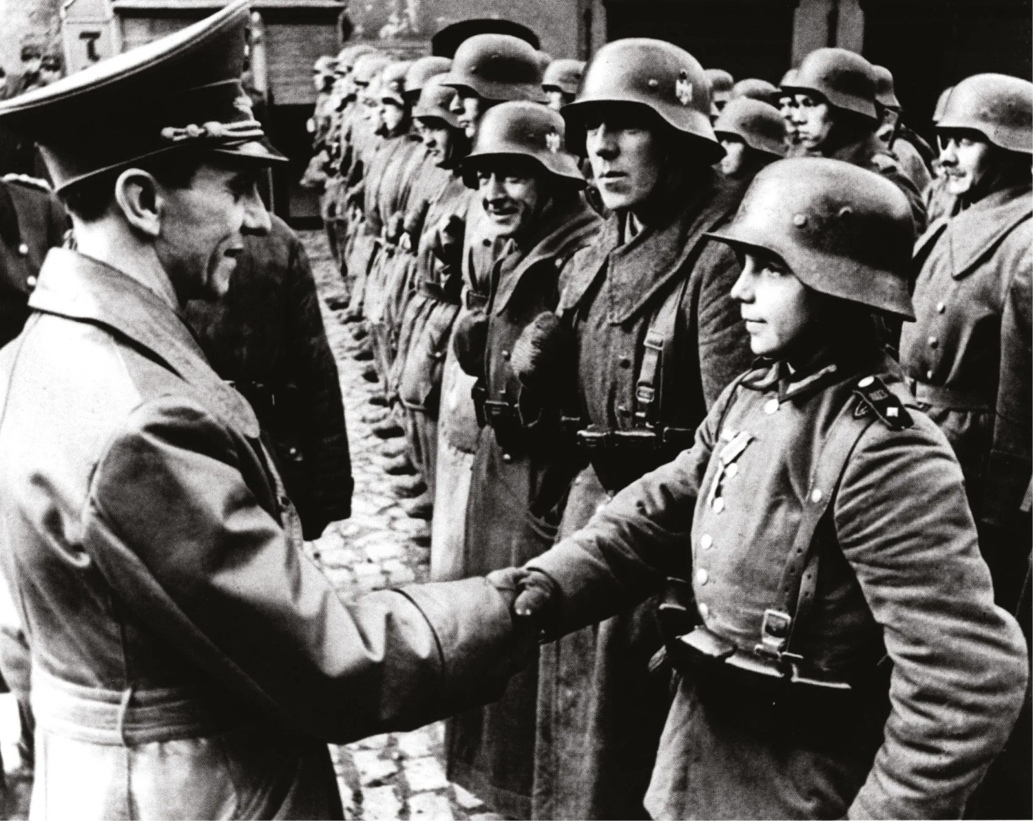 BELOW Goebbels inspects some of the last defenders of the Third Reich.