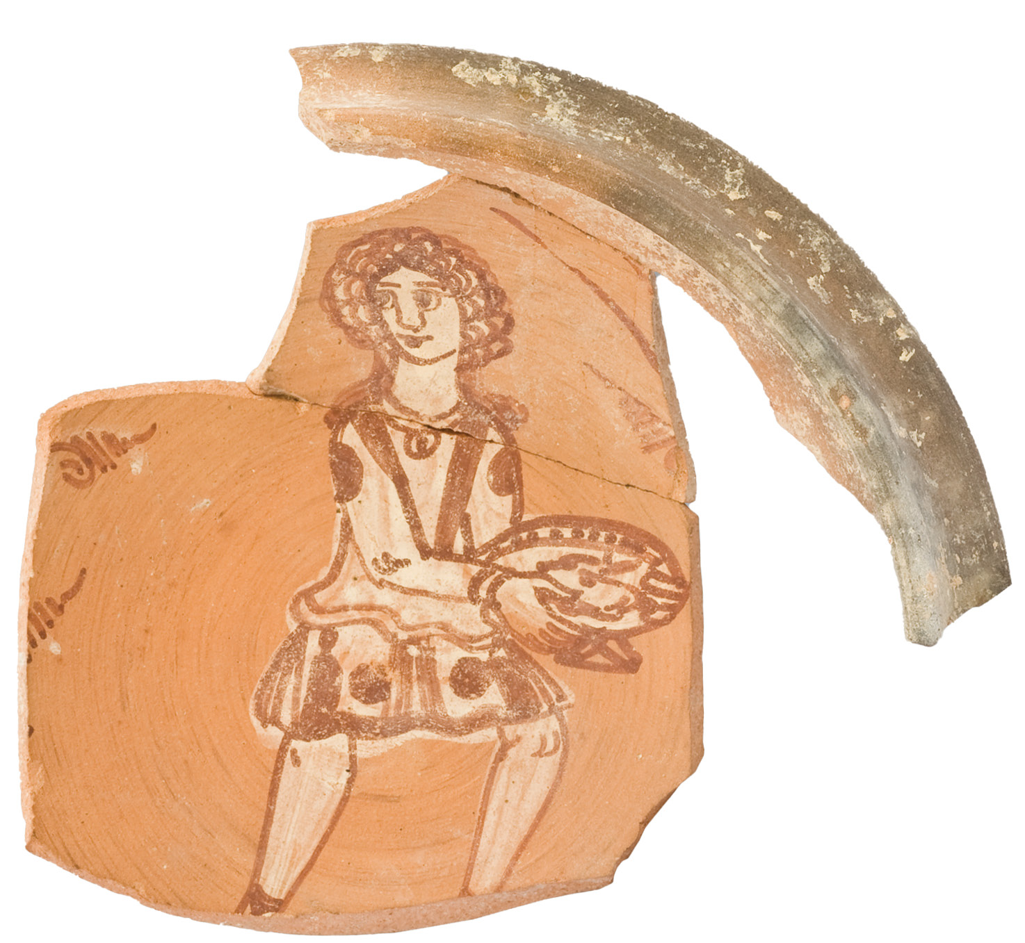 LEFT A Jerash bowl showing a young male, most likely a servant. Such bowls were painted on the inside with two colours, and sometimes feature stamped decoration. This type of bowl was manufactured in the city in Late Antiquity, from the mid-6th century to the mid-7th century AD.