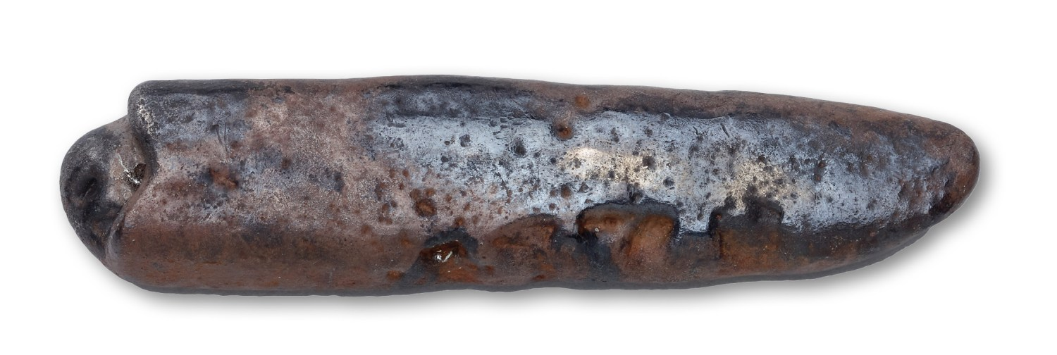 ABOVE A single silver ingot (65mm long)was retrieved from the thieves, but their photographs suggest that the hoard had originally contained several such objects something that would be unsurprising, as ingots are typical components of late 9th- and 10th-century Viking hoards.