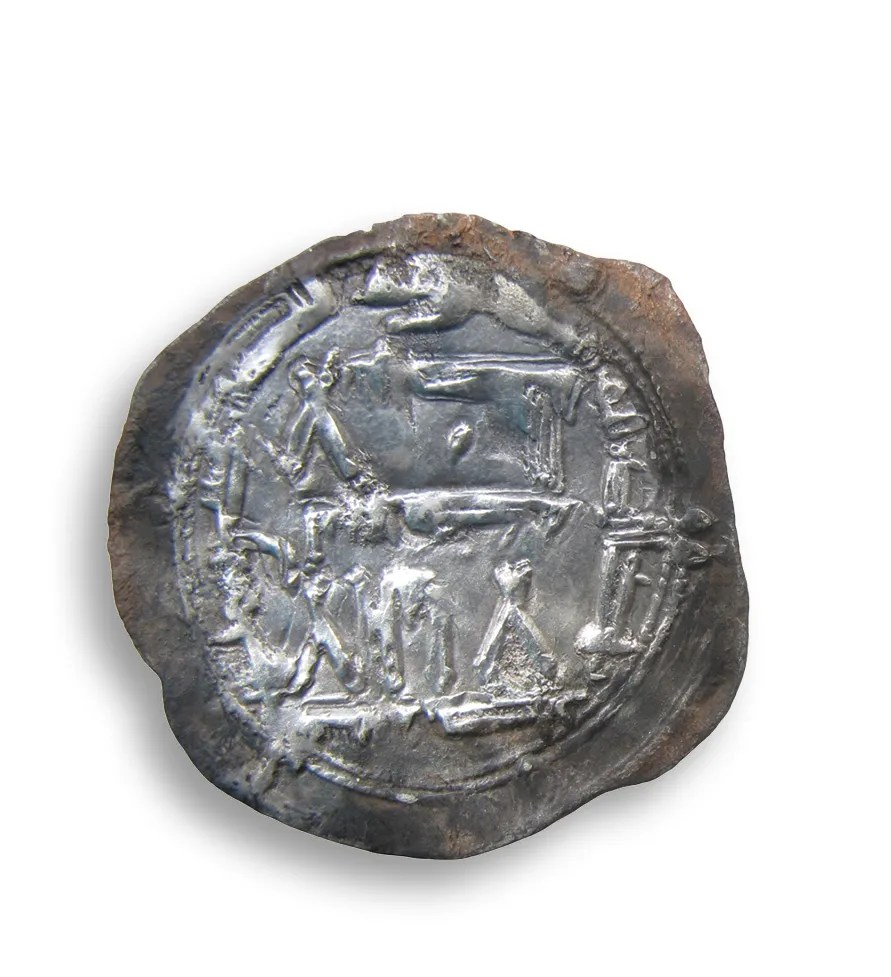 Most of the known coins from the hoard are Anglo-Saxon, but there were two more 'exotic' examples: an Arab silver dirham, probably minted in 8th-century Iran (below), and a 9th-century silver denier of the Frankish king Louis the Pious (BOTTOM).