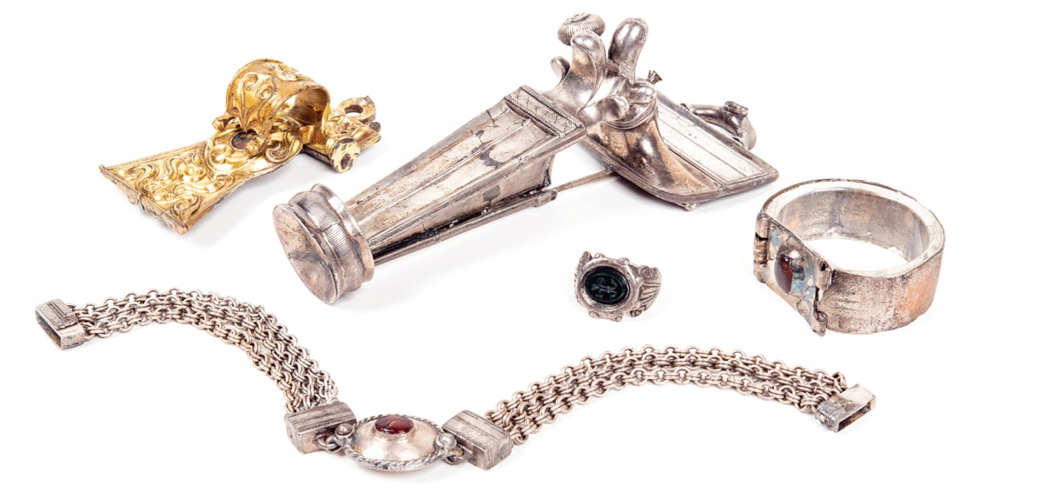 below Some of the jewellery from the Aesica (Great Chesters) Hoard. Its contents include objects much older than the date of its burial perhaps treasured heirlooms or antiques acquired by its owner.