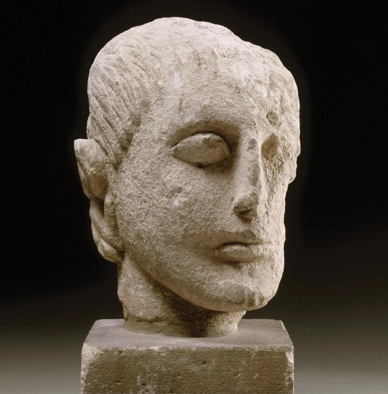 right Head of a man, from the sanctuary of Cerro de los Santos (Albacete). 4th century BC, limestone. Size: 20.5 x 11 x 19cm