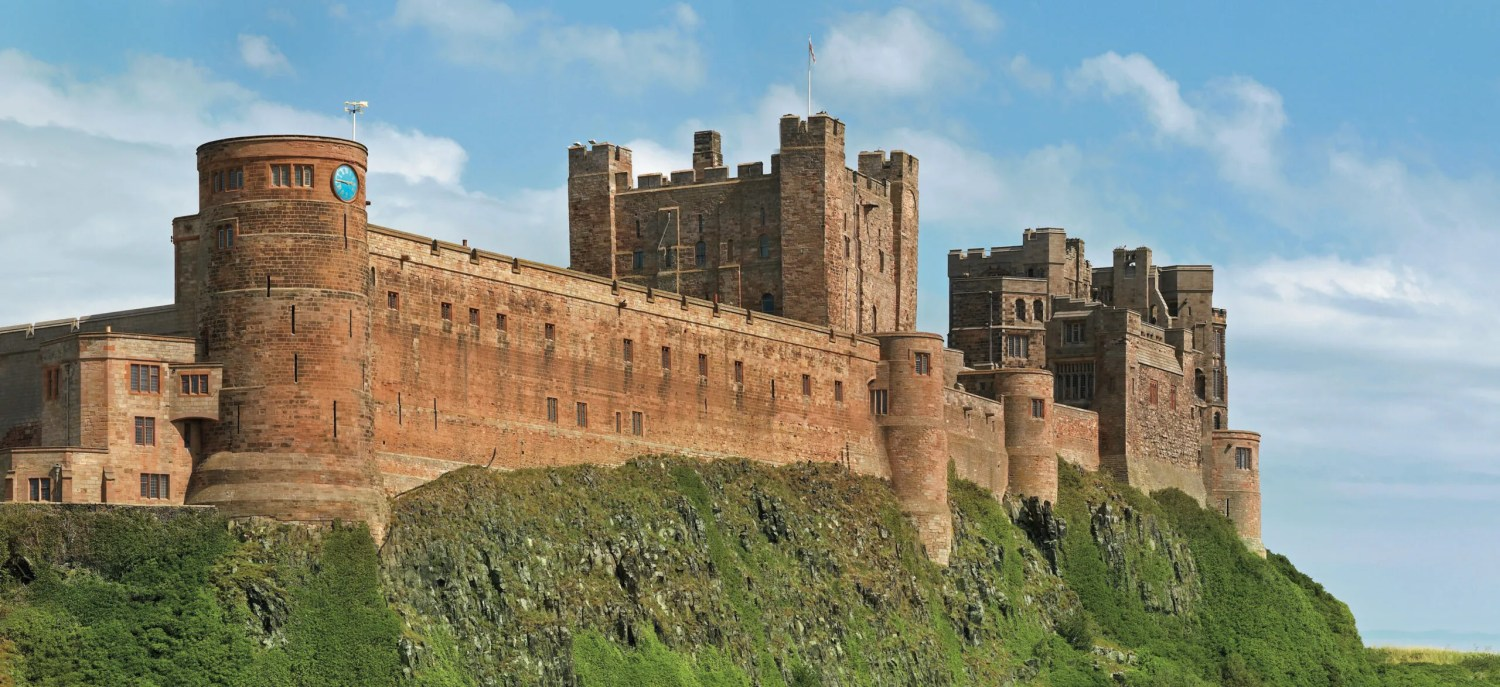 above Bamburgh Castle, Northumberland. The rocky outcrop was first settled by native Britons, followed by Anglo-Saxon, Norman, and English kings. It is now privately owned.