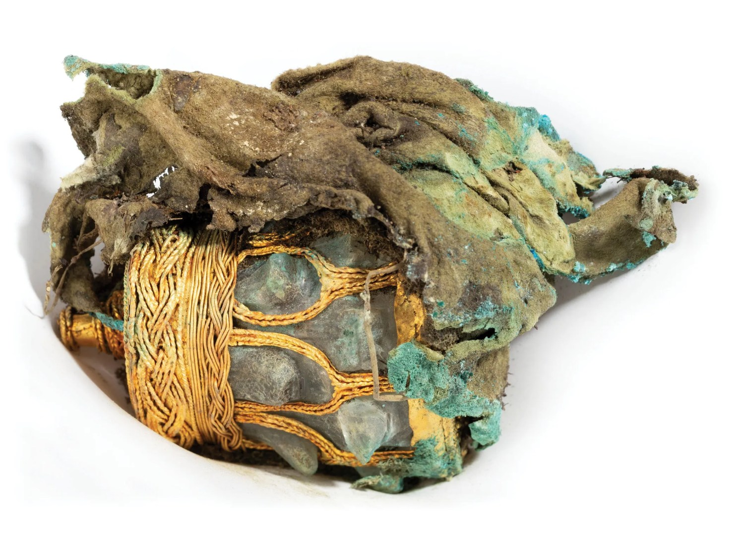 above A rock crystal jar, decorated with gold-filigree ornamentation, from within the Galloway Hoard vessel. The jar is bundled in a leather pouch and layers of textile, fragile materials which mean the object cannot go on view in the exhibition.