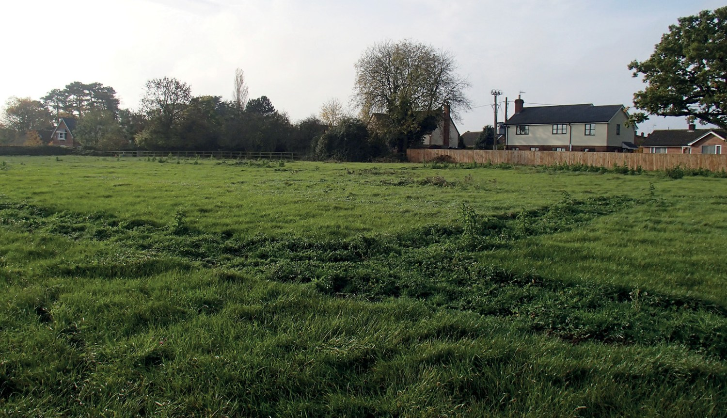 BELOW The smithy site was reasonably well preserved, despite being historically under the plough; the original building seems to have been constructed on empty land, and the site returned to 'green field' after it was abandoned.