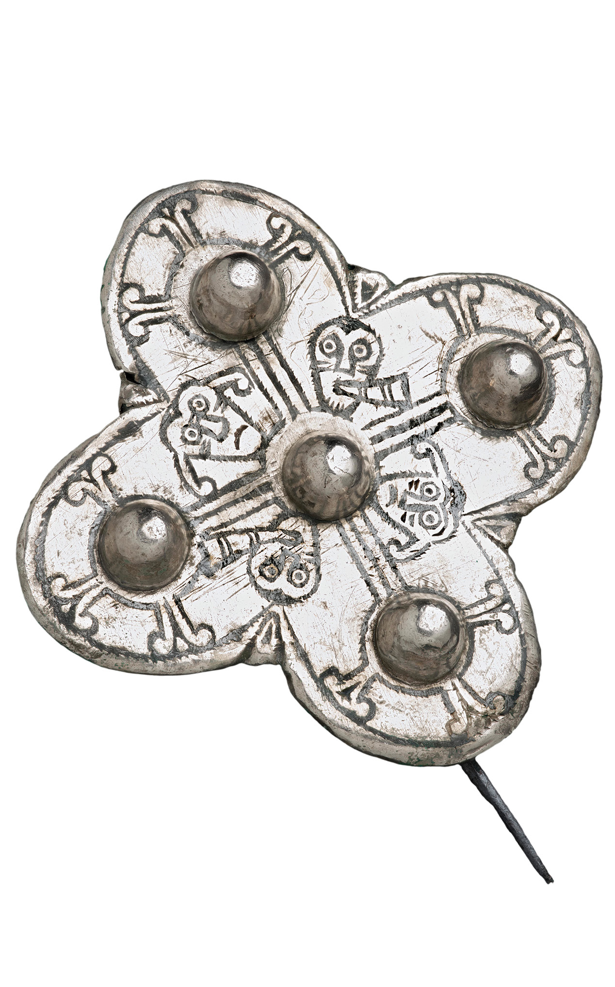 left One of two Late Anglo-Saxon silver quatrefoil brooches depicting two of the five senses sight and hearing. On this example exaggerated ears are ringing from the blowing of blast horns.