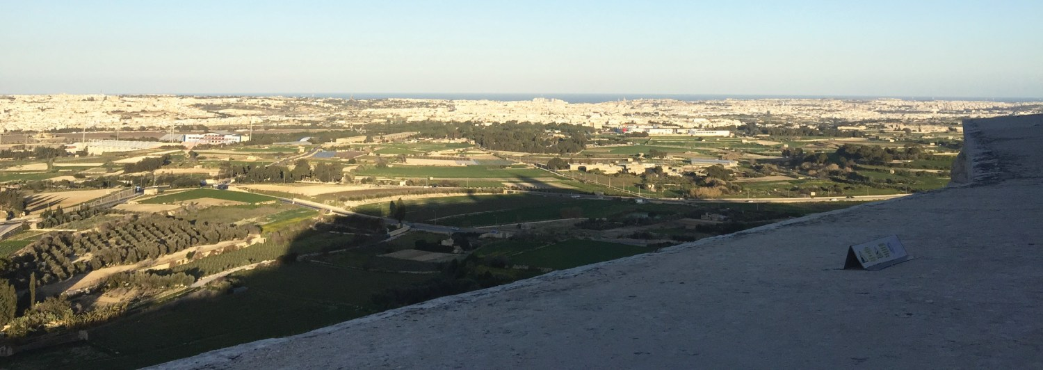 below View across Mdina, towards the sea. Though the island has been heavily developed in places, it is a land rich in archaeology and history.