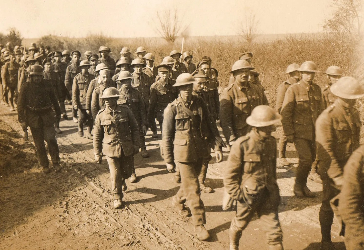 BELOW A column of British POWs on the Western Front is marched away.