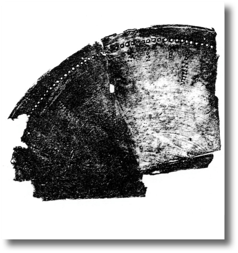 Above The fragment from Grand in the Vosges represents a bronze disc only 35cm across. It is crude and has no map, but it bears calendrical information alongside the holes.