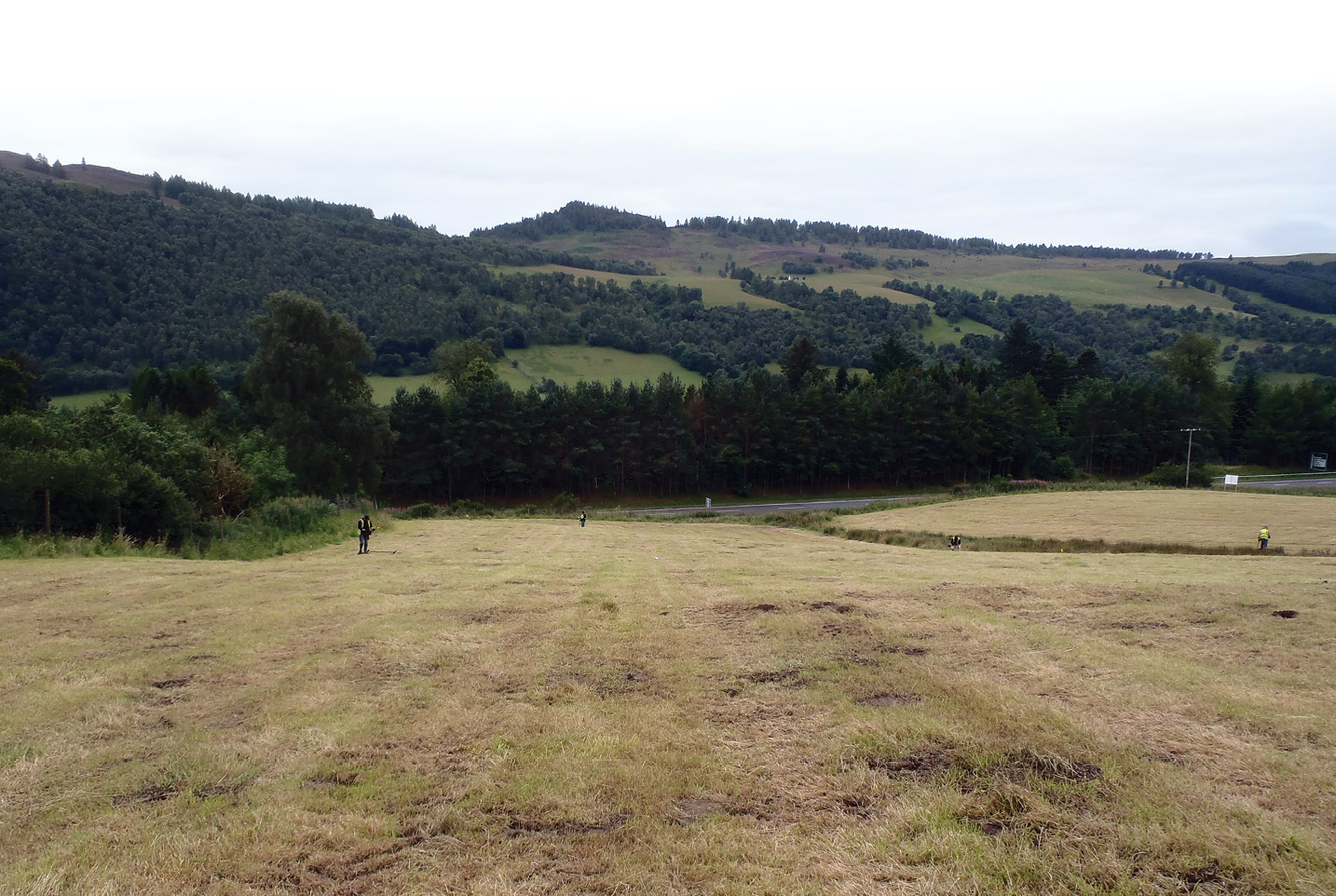 Below Metal-detectorists north of Urrard House. The survey confirmed that this is where some of the heaviest fighting took place, near Mackay's right flank.
