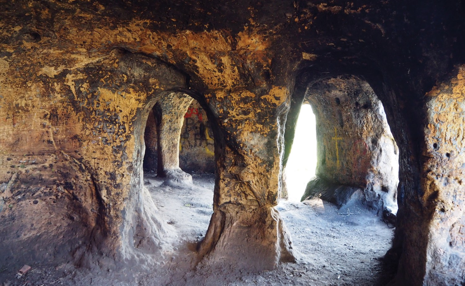 below The interior shows early doors and 'pillars', which are in fact the remains of dividing walls that were partially knocked through in the 18th century, when the cave became the picturesque location of aristocratic parties.
