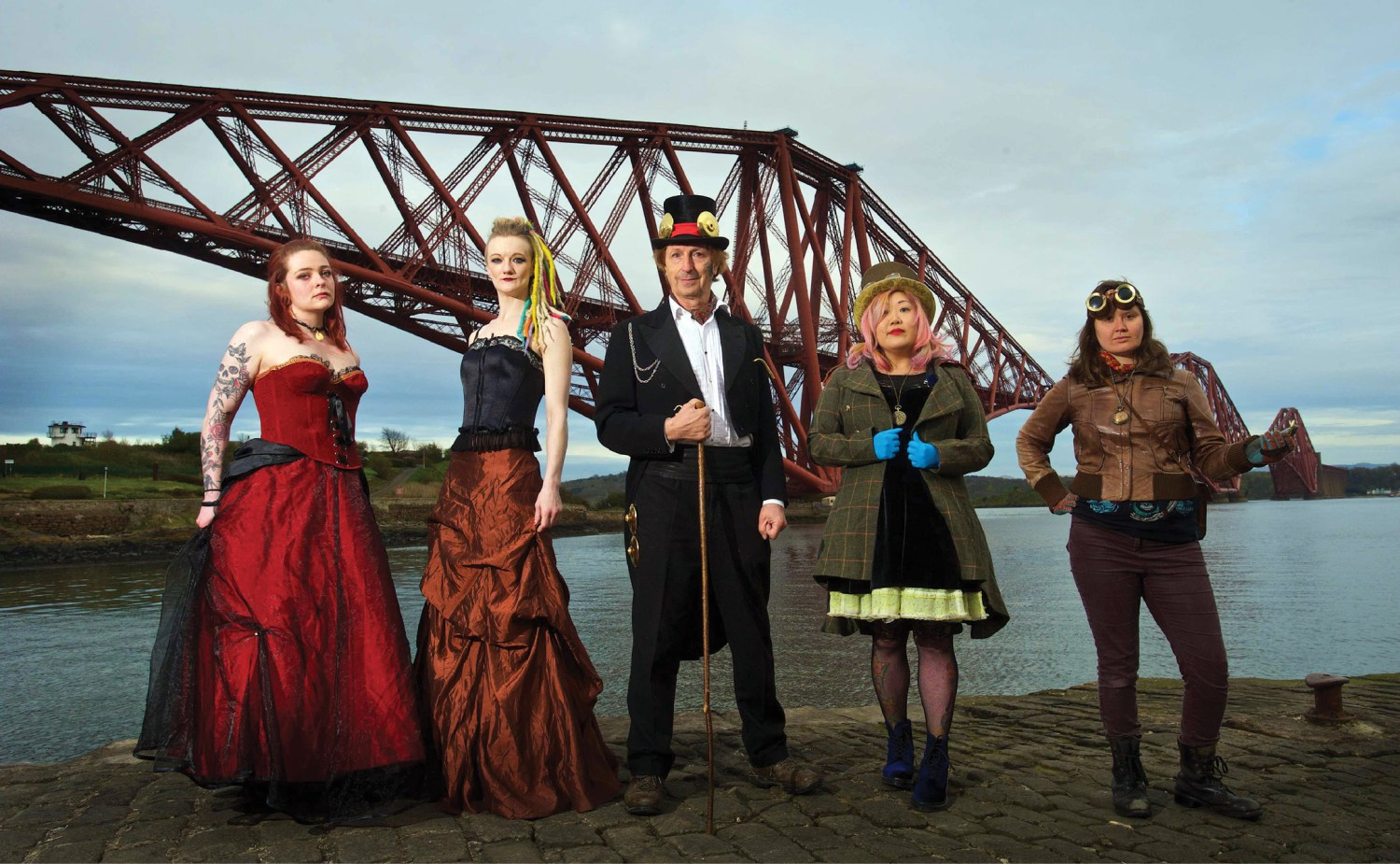 above Steampunk enthusiasts gather at Forth Bridge in their Victorian-inspired finery.