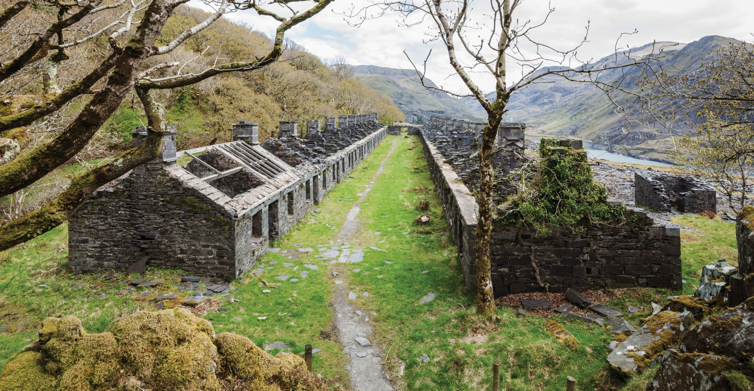 below These now roofless dwellings at the Dinowric quarry were built as so-called 'barracks' for unmarried quarrymen, or for father and son, uncle and nephew. Each unit consists of two or three rooms, with a communal kitchen at one end of the terrace.