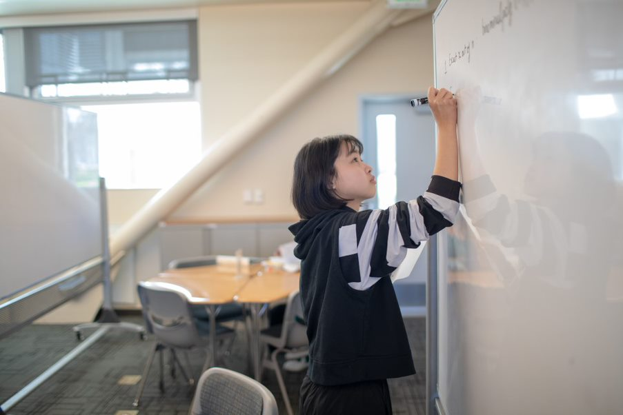 SJCC math student studies with her peers on campus.