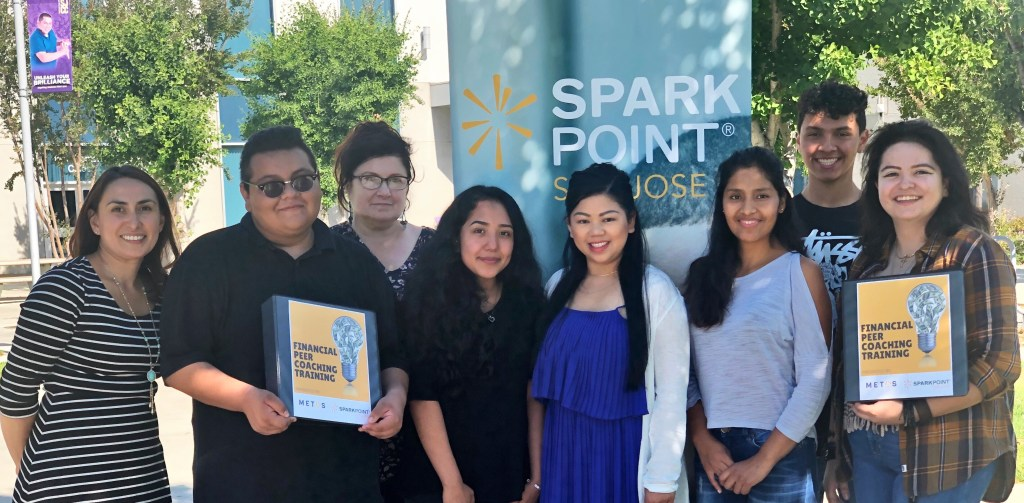 METAS and SparkPoint students pose for a photo after Financial Peer Coaching Training.