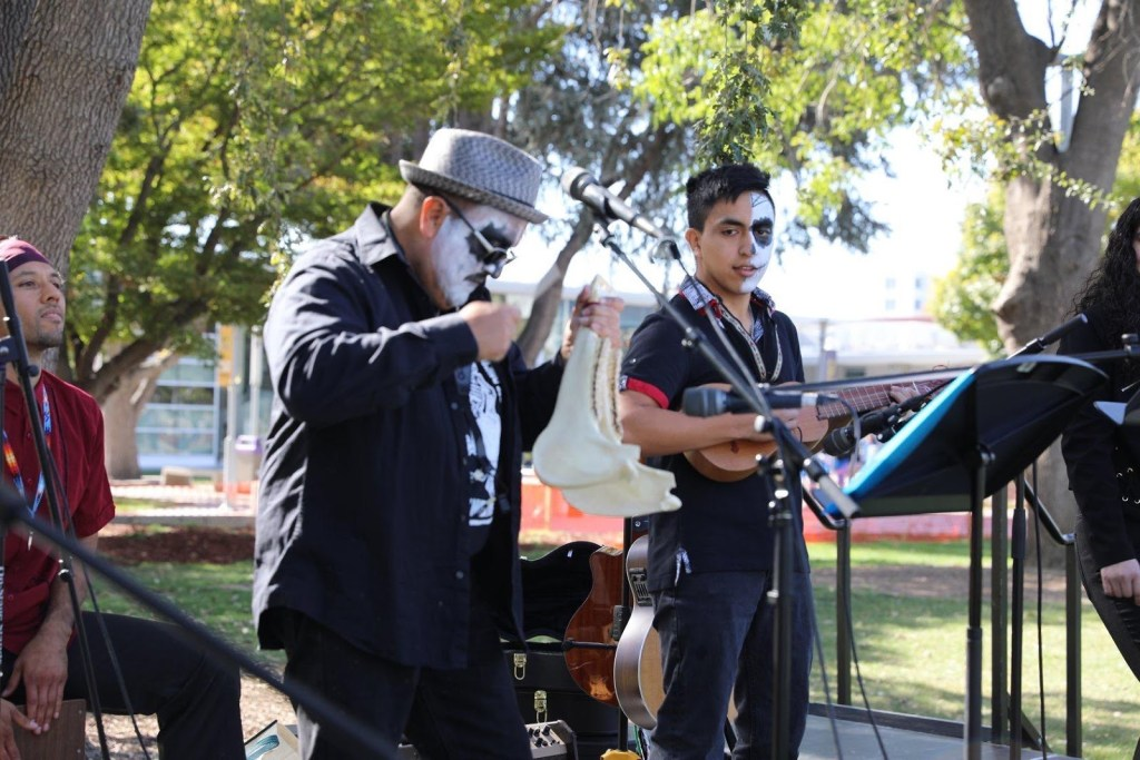 Former Chicano Studies student, Joaquin Covarrubias performs in the musical group, the Jag-Tones at the Día de los Muertos celebration in 2019.