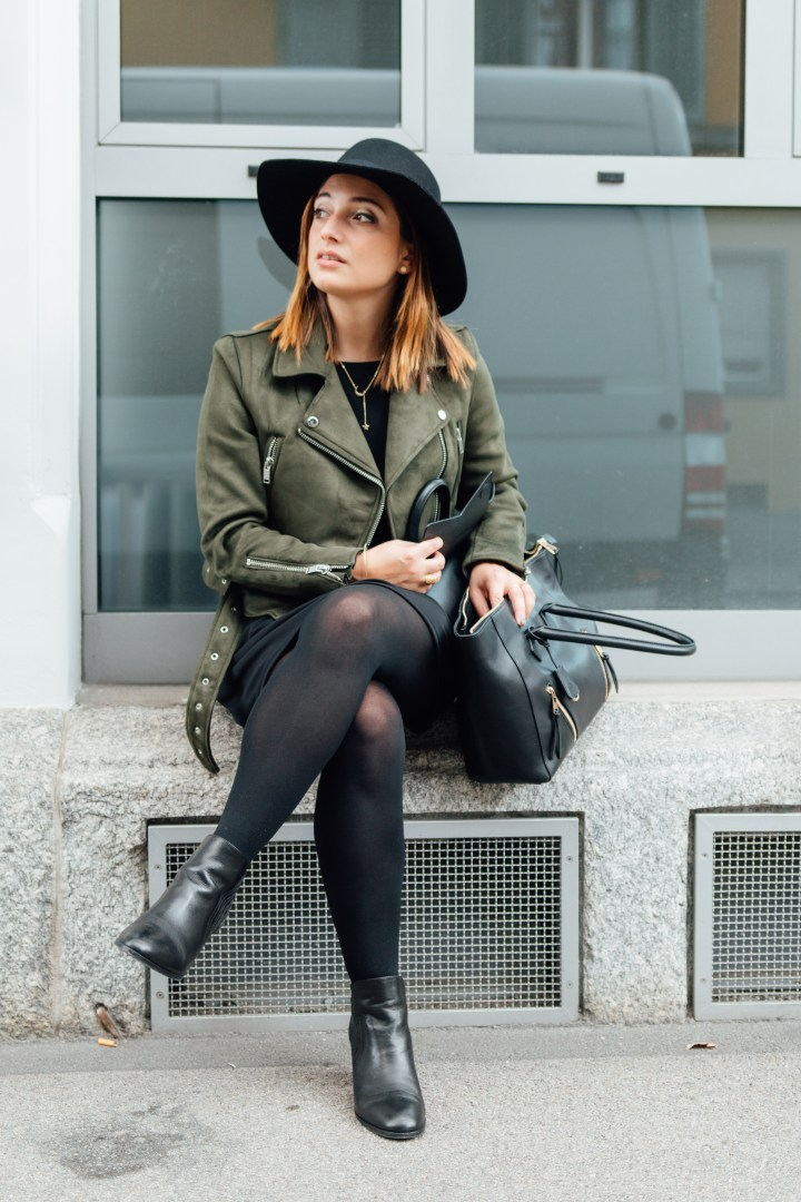 Sitting with autumn outfit and black boots