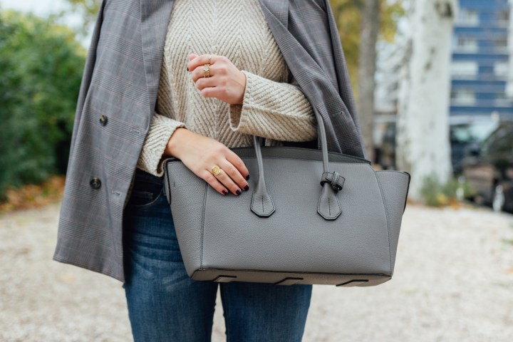 Beige turtleneck and grey bally bag outfit