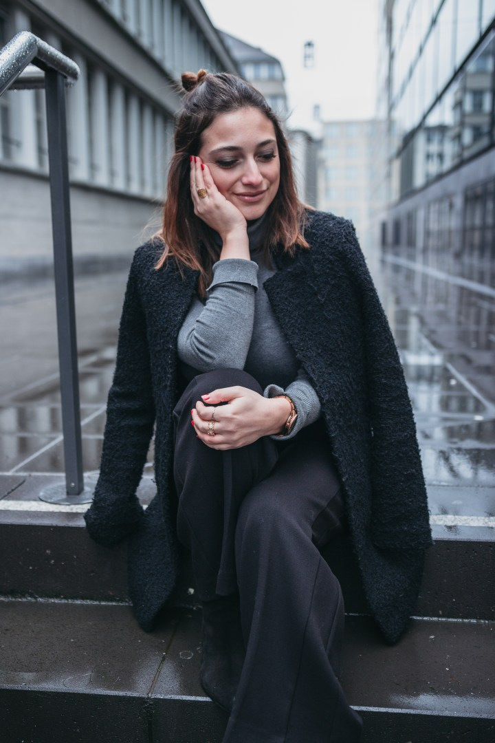 Street style with black coat in Zurich