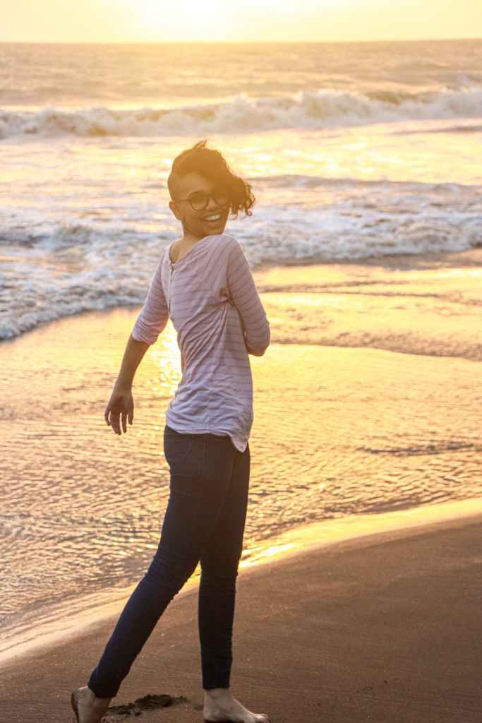 woman living fearlessly on beach